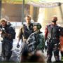 Cast of Suicide Squad in full costume seen filming on the movie sets in Toronto